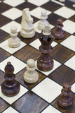 Chess piece figure standing on chess board Royalty Free Stock Images