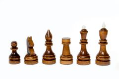 The shot of the black chess set of wood on the white background. The chess piece is isolated on white and a clipping path is provided for easy extraction Stock Images