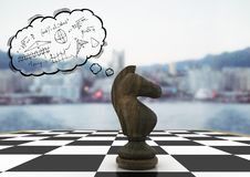 Chess piece and thought cloud with math doodles against blurry skyline Royalty Free Stock Photos