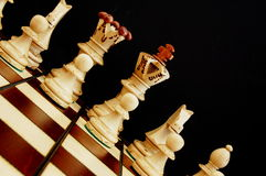 Chess pieces. Showing power competition conflict and strategy in business royalty free stock images