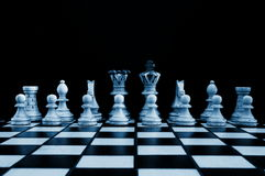 Chess pieces. Showing power competition conflict and strategy in business royalty free stock photo