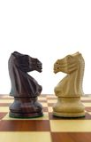 Chess pieces. Black and white knight Stock Photos