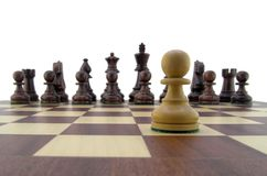 Chess pieces. White pawn looking down the chessboard Stock Photography