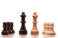 Chess pieces. Black and white chess pieces isolated on a white background stock photo