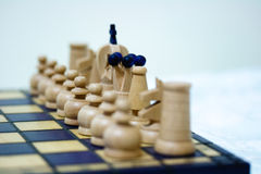 White set of chess pieces on board Stock Photo