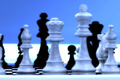 Chess pieces. With a blue white background Royalty Free Stock Photography