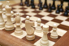 Chess pieces. On wood board Stock Photos