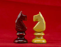 Chess pieces. On red background Royalty Free Stock Images