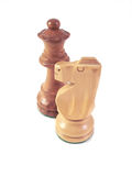 Chess Pieces. Two chess pieces one brown and one white over a white background royalty free stock photo