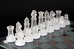 Chess pieces. Made of glass over black background stock photo