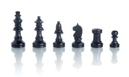 Chess pieces. Complete set of chess pieces isolated on white with reflection Stock Photos
