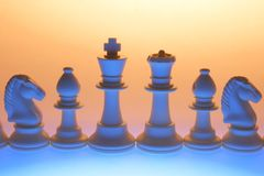 Chess Pieces. Blue Chess Pieces on Gold Background stock photos