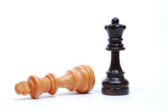 Chess Pieces. Queen and fallen King royalty free stock photos