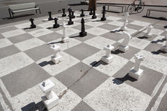 Chess pieces on asphalt at park Stock Images
