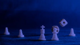 Chess pieces on the background of the fabric Royalty Free Stock Images