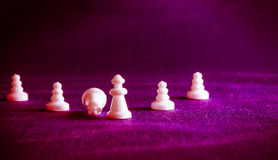 Chess pieces on the background of the fabric Royalty Free Stock Image