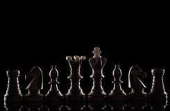 Chess pieces on black background Royalty Free Stock Photography