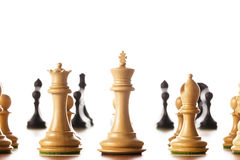 Chess pieces. Black and white chess pieces standing on a chessboard Royalty Free Stock Images