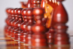 Chess pieces on board Stock Photos
