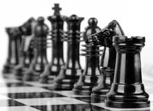 Chess pieces on board Royalty Free Stock Photos