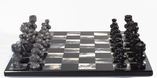 Chess Pieces and Board. Onyx stone hand-carved chess set board and pieces Royalty Free Stock Photo