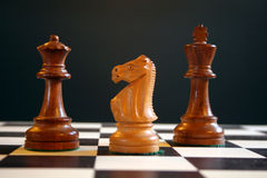 Chess pieces on board. Chess pieces on chess board Stock Images