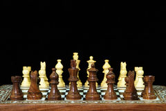 Chess pieces and board on black Stock Photography