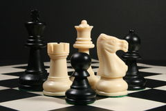 Chess pieces on board with black background Stock Photo