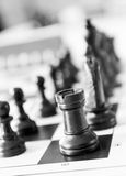 Chess pieces on the board close up. Stock Photos