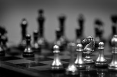 Chess Pieces on Board for Game and Strategy Stock Photos