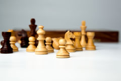 Chess pieces on the board. On white background Stock Photo