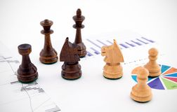 Chess pieces on business background Royalty Free Stock Photos