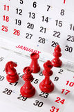 Chess Pieces on Calendar Royalty Free Stock Photos