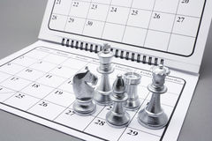 Chess Pieces on Calendar Royalty Free Stock Photos