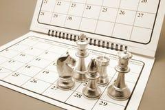 Chess Pieces on Calendar Stock Photos