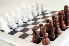 Chess pieces on ceramic board Stock Image