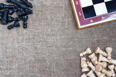 Chess pieces and chess board on sacking Royalty Free Stock Images