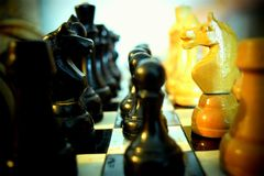 Chess pieces on a chessboard stock photography