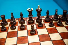 Chess pieces on the chessboard, dark side before the start of the game. royalty free stock photography