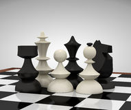 Chess pieces on the chessboard Stock Image