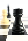 Chess pieces on a chessboard Stock Photo
