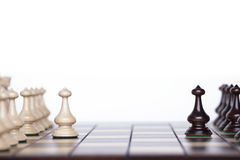 Chess pieces on a chessboard. Stock Photos