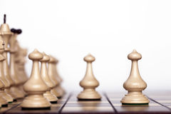 Chess pieces on a chessboard. Royalty Free Stock Image