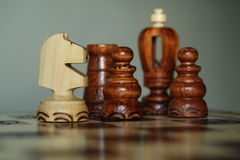 Chess pieces on the chessboard. Wood chess pieces on the chess board Stock Photo