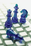 Chess pieces on Computer Keyboard. Close Up of Chess pieces on Computer Keyboard Stock Photos