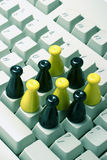 Chess Pieces on Computer Keyboard Royalty Free Stock Photo