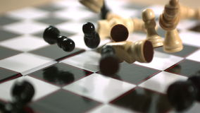 Chess pieces crashing onto board stock footage