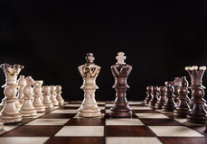 Chess pieces on dark background Royalty Free Stock Images