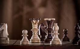 Chess pieces on dark background. Close-up stock illustration