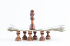 CHESS PIECES AND DOLLAR BILLS Stock Image